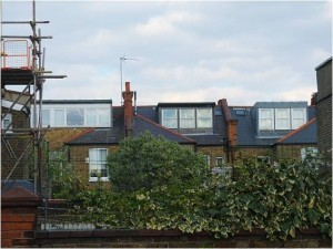 Rear dormers as part of loftrooms. The one in the centre conforms with current RBKC guidelines