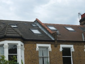 Front rooflights damage the view of roofscapes (image not from within the Conservation Area)